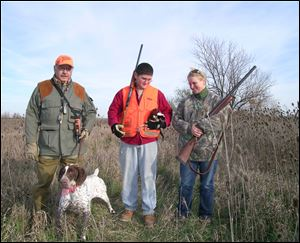 Instructor Rick Lopez, left, Jason Adams, and Gretchen Kruse join forces in a 'Wingshooting 101' pheasant hunting experience.