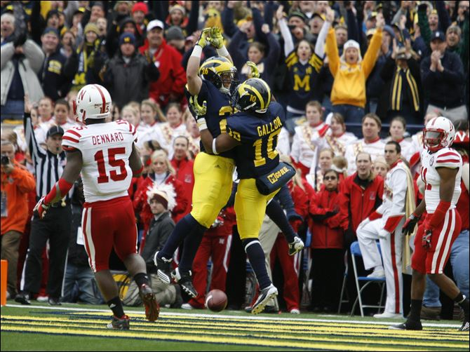 Big Ten bullies now reside in Ann Arbor Michigan's J.B. Fitzgerald celebrates his fumble recovery against Nebraska with teammates Josh Furman, left, Brandin Hawthorne (7), and Thomas Gordon in the fourth quarter.