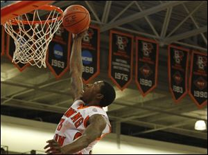 BGSU's Torian Oglesby goes up for two over Austin Peay defenders during game at BGSU's Stroh Center in Bowling Green , Ohio.
