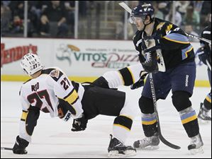 Walleye player Nick Oslund, 22, knocks down Cyclones player Chris Reed, 27.