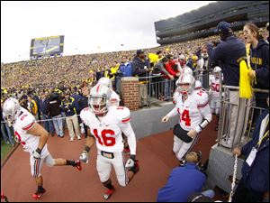 Ohio State University players take the field to play the University of Michigan at the Big House Saturday.