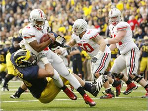 Michigan's Ryan Van Bergen (53) sacks Ohio State  quarterback Braxton Miller (5) during the first quarter at the Big House Saturday.