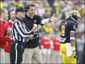 Ohio State interim coach Luke Fickell protests a call during the first quarter of the Buckeyes' game against rival Michigan at the Big House Saturday.