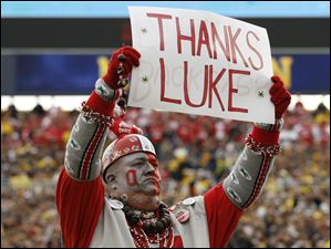 Jon Peters of Fremont cheers for the Buckeyes during Saturday's rivalry game against Michigan in Ann Arbor.
