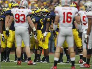 Michigan quarterback Denard Robinson (16) stares down the Ohio State defense during the third quarter. Robinson accounted for five touchdowns in Saturday's game.
