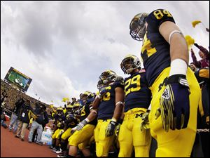The Wolverines prepare to take the field to play Ohio State at the Big House Saturday.