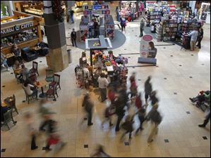 Shoppers look for deals at Westfield Franklin Park Mall in Toledo.