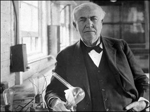 "Thomas Alva Edison, holds his ""Edison Effect"" light bulb in his West Orange, N.J., laboratory, the first long-lasting, practical electric light bulb."