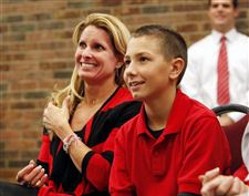 Urban-Meyer-Shelley-Meyer-Nathan-Meyer-press-conference