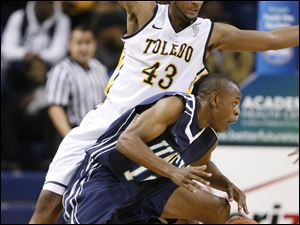 Toledo's Matt Smith (43) puts pressure on UNC-Wilmington's Freddie Jackson (10).