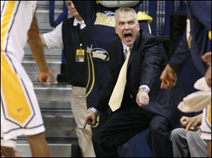 Toledo head coach Tod Kowalczyk yells that a UNC-Wilmington's stepped out of bounds.