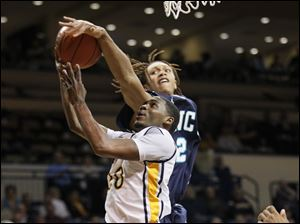 Toledo's Julius Brown (20) has this shot blocked by UNC-Wilmington player Keith Rendleman (2).