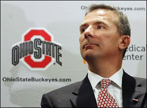 With a pair of national titles while at Florida, Urban Meyer, the new head c