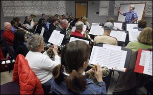 Fred Dais conducts during a rehearsal of the Owens Concert Band shortly after it was formed in January, 2010. Made up of students and community members, the band will perform Sunday in the Mainstage Theatre on campus.
