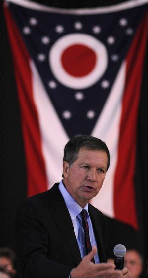 Gov. John Kasich reads news on electronic gadgets, a spokesman says.