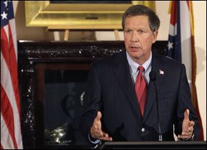 Gov. John Kasich says a headline called attention to a state problem he later addressed.
