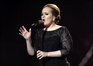 Adele performs during the Brit Awards 2011 at The O2 Arena in London.