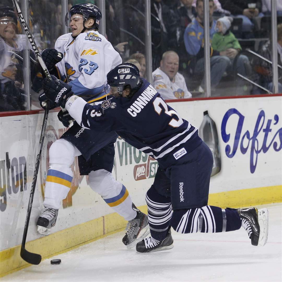 Walleye-player-Byron-Froese-23-is-hit-by-Greenville-Warriors-player-Wes-Cunningham