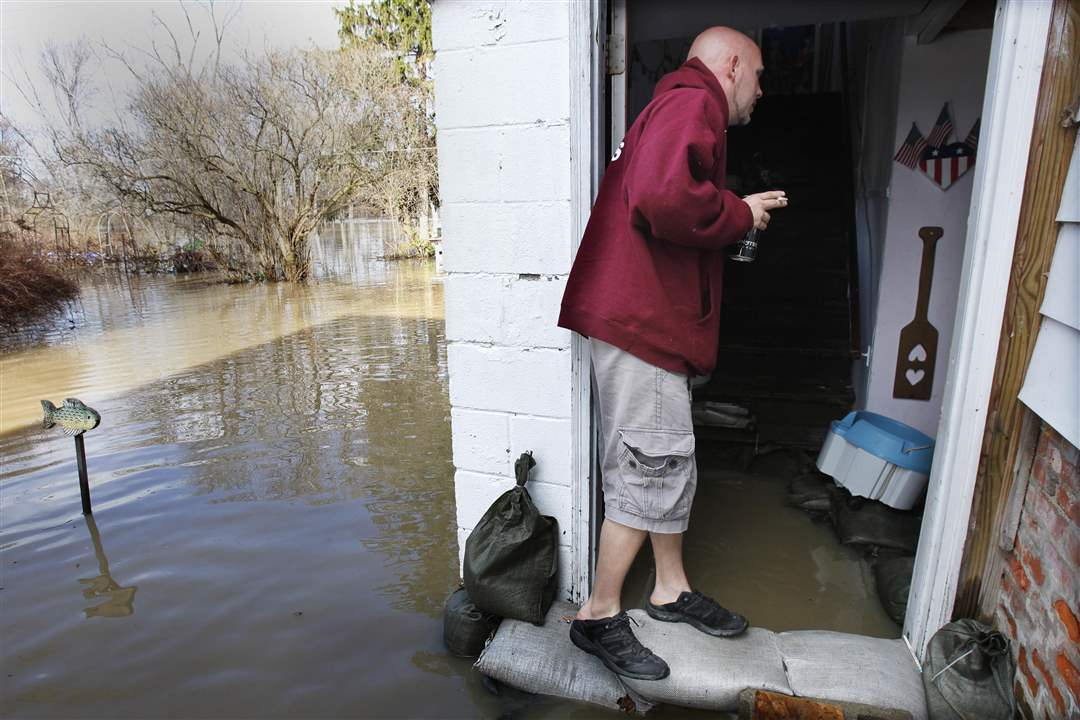 W-Monroe-St-resident-Nick-Polley-monitors-flood-waters