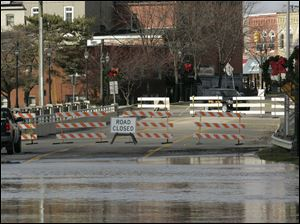 The M50 Bridge in Dundee, Mich. is closed due to flooding of the River Raisin.