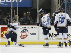 Toledo Walleye player Christopher DiDomenico, 24, left, celebrates his second period goal with teamamtes Brian Matte, 42, and Ryan Blair, 18.