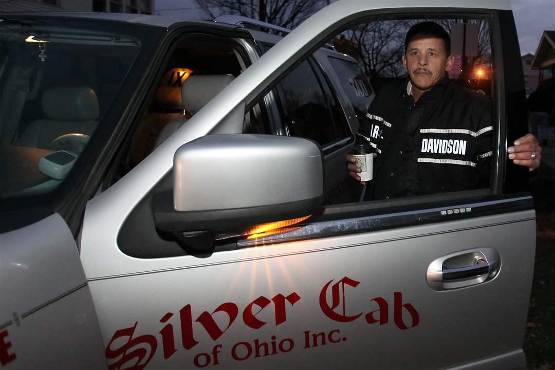 Adrian-Garcia-owner-of-Silver-Cab-of-Ohio-gets-into-his-cab-during-a-vigil-for-Scott-Holzhauer
