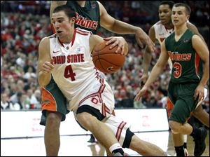 Ohio State's Aaron Craft (4) drives to the basket past Texas-Pan American's Ruben Cabrera (13) during the second half of an NCAA college basketball game Saturday in Columbus.