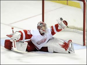 Detroit Red Wings' Jimmy Howard (35) makes a save against the Buffalo Sabres during the third period of an NHL hockey game in Buffalo, N.Y., Friday.