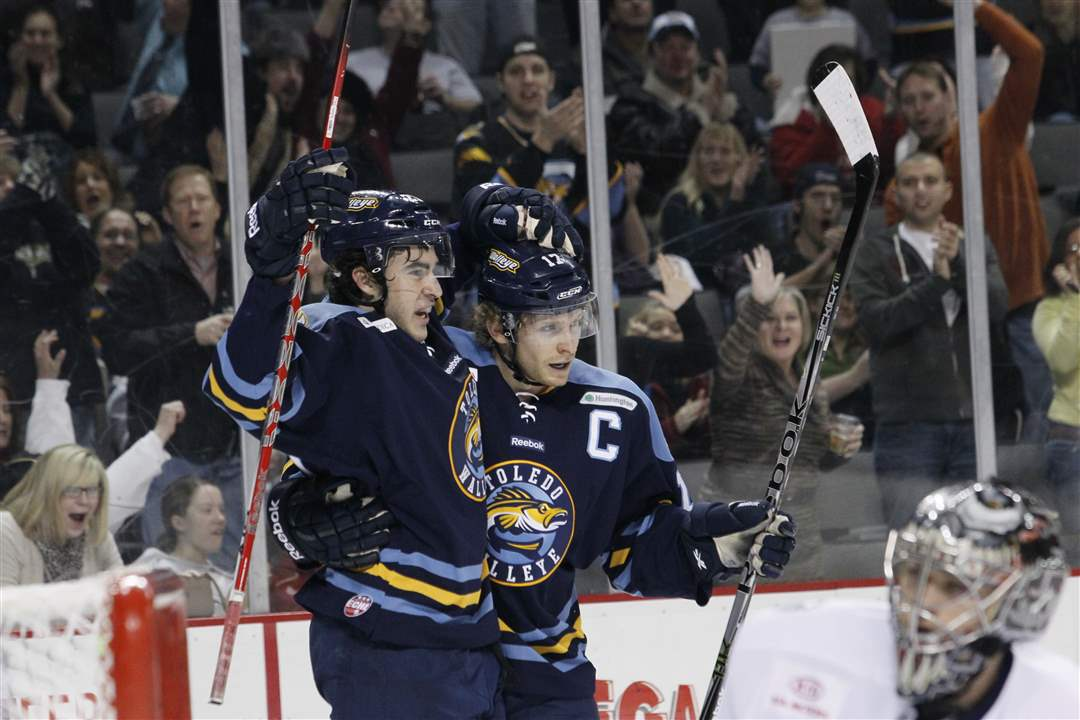 Toledo-Walleye-players-Trevor-Parkes-left-and-Kyle-Rogers-celebrate-a-goal