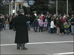 Sylvania town crier Michael Lieber announces the arrival of Santa.