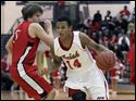Central Catholic's DeShone Kizer (14) drives past  Bedford's Brendan Renius (5).