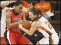 Austin Peay's #2, Shyra Brown tries to hold on to the ball as BGSU's #21, Chrissy Steffen, attempts to take it away in the first half. The Bowling Green State University women's basketball team hosted Austin Peay at the Stroh Center in Bowling Green on December 10, 2011.