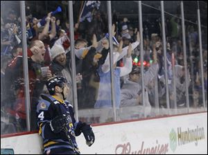 Joey Martin (14) doesn't celebrate with the crowd as he knows his goal against the Cincinnati Cyclones is waved off.