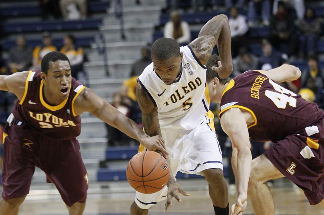 UT-player-Pearson-is-fouled-by-Loyola-Chicago-s-Christian-Thomas