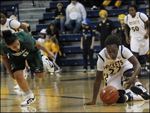 Cleveland's Honesty King loses the ball on a steal from Andola Dortch during 2nd half at Savage Hall in Toledo, Ohio.