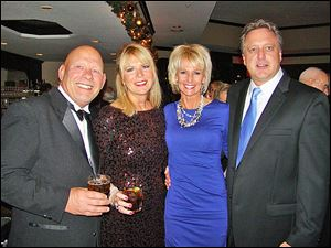 Enjoying themselves at Stone Oak Country Club's 20th Annual Lighting of the Lights Gala were Greg Meyers, Lori Moffitt, Terri Schmakel, and Jeff Dykas.
