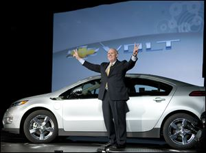 Daniel F. Akerson stands near a Chevy Volt in Detroit. Since taking over GM in 2010, Mr. Akerson has  led the firm through turbulence, but he faces challenges ahead.