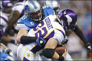 Vikings running back Toby Gerhart (32) is tackled by Lions defensive end Kyle Vanden Bosch (93) in the first quarter.
