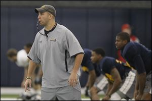 Matt Campbell, University of Toledo's new interim football coach, runs drills with his players during practice at the UT campus on Friday.
