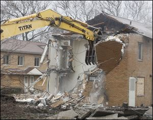 Work crews begin demolition of the Albertus Brown housing project in Toledo.