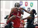 Rogers' Sasha Dailey (1) goes to the net against Start's Tai'ma James (1) and Dasia Daniel (5).