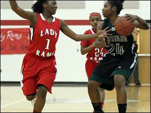 Rogers' Sasha Dailey (1) defends against Start's Torie McDuffie (24).