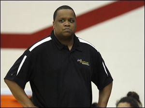 Start head coach Leon Kynard watches the action against Rogers.