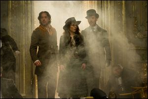 Robert Downey Jr., Noomi Rapace, and Jude Law star in 'Sherlock Holmes: A Game of Shadows.'