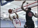 Bowsher's Mookie Mustafaa (24) puts up a shot against Scott High School's Jermul Richardson (42) during the first quarter.