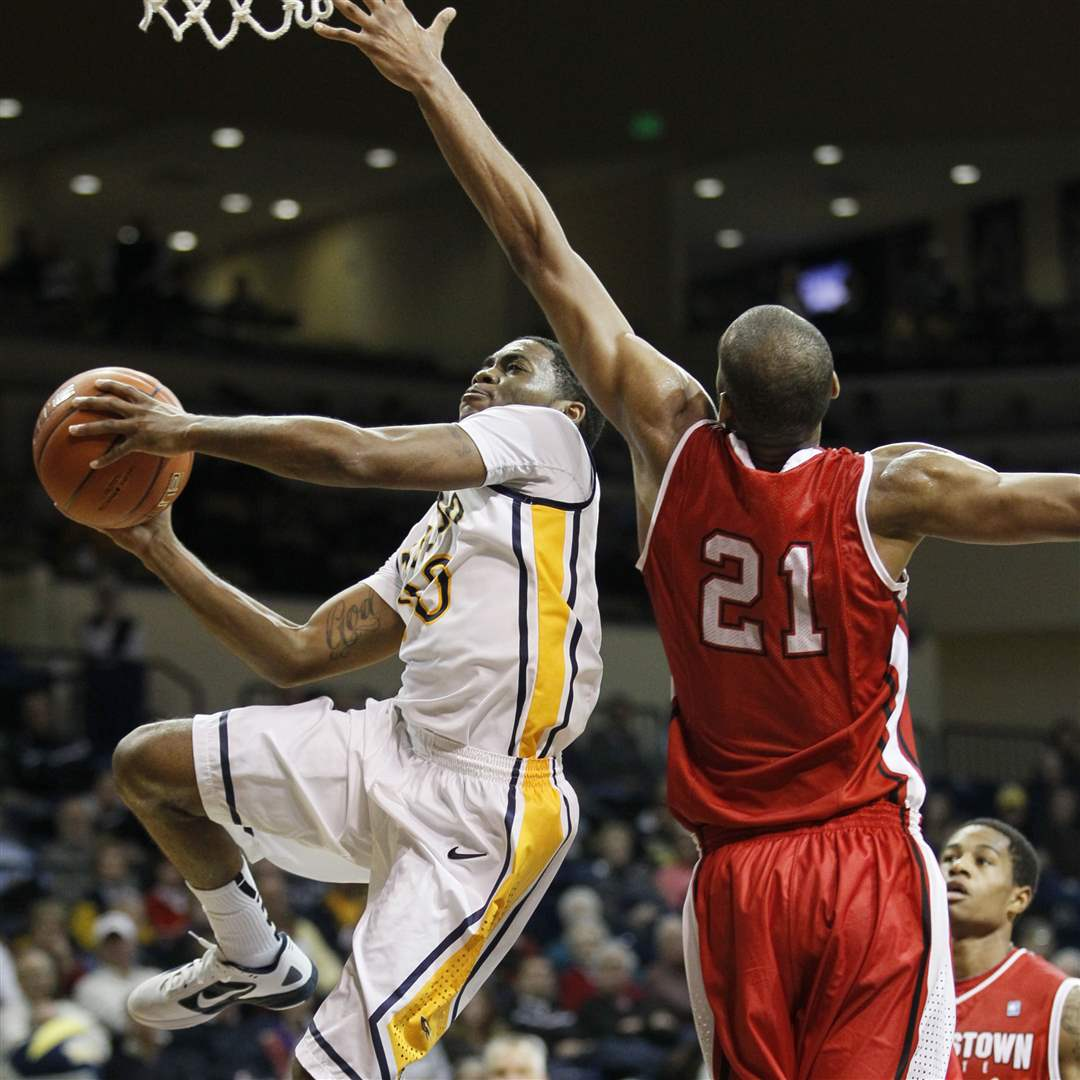 UT-player-Julius-Brown-soars-past-Youngstown-State-s-Damian-Eargle