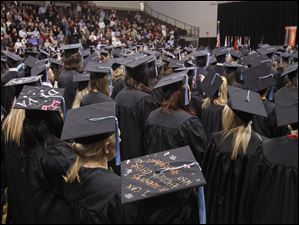 Graduates attend the Bowling Green State University's 272nd graduation at The Stroh Center at Bowling Green State University in Bowling Green.