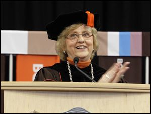 University president Mary Ellen Mazey applauds the graduates during the Bowling Green State University's 272nd graduation at The Stroh Center at Bowling Green State University in Bowling Green.