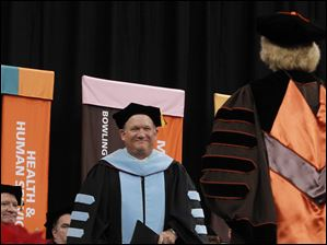 Commencement speaker Dr. Robert DeBard is introduced during the Bowling Green State University's 272nd graduation at The Stroh Center at Bowling Green State University in Bowling Green.