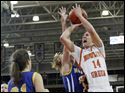 Bowling Green State University guard Jessica Slagle (14) goes to the net against Madonna guard Heather Pratt (4).